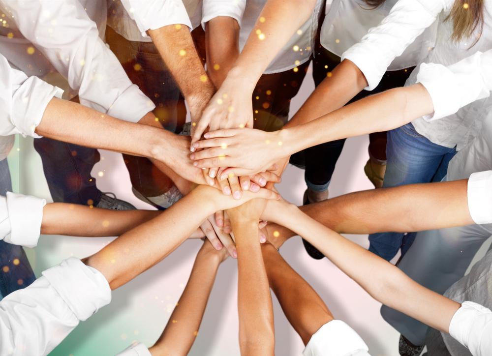 Hände des Teams